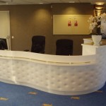 High quality reception desk with a complicated combination of materials.